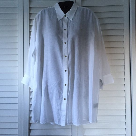 Ralph Lauren XL White Linen Shirt Timeless 100% linen white shirt. Long. Could be used as a dress for a petite lady. It came back from the cleaners with 2 small tan marks. (See photo) Ralph Lauren Tops Button Down Shirts