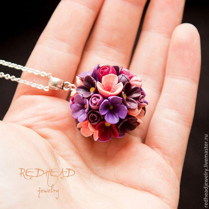 colgante < flores de colores