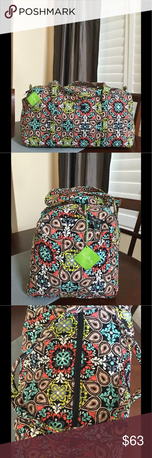 "NWT VERA BRADLEY LARGE DUFFEL Brand new with tags Vera Bradley large duffel  Sierra pattern  15"" strap drop Handy outside end pocket Folds flat for easy storing Dimensions 22"" W x 11½"" H x 11½"" D - 15"" strap drop Duffle Smoke/pet free home Vera Bradley Bags Travel Bags"