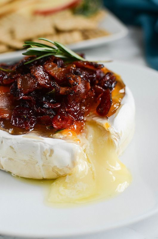 Bacon Cranberry Baked Brie - the perfect holiday appetizer! The sweet and salty combo is so delicious!