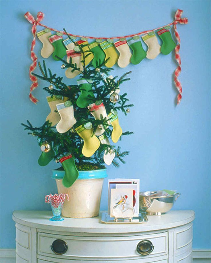 433 best diy dcor ideas images on pinterest a bunny crafts and mini stocking tree creative christmas tree decorating ideas martha stewart living these stockings are negle Image collections