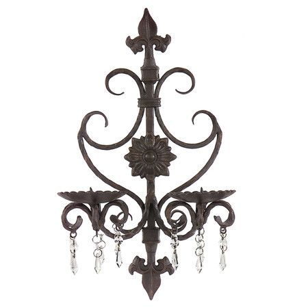Wrought iron candle sconce with crystal accents.    Product: Candle sconceConstruction Material: Wrought iron