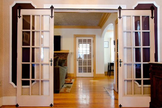Rolling glass french doors for the inside... Lovely, but maybe sheer curtains to allow privacy, but light during the day