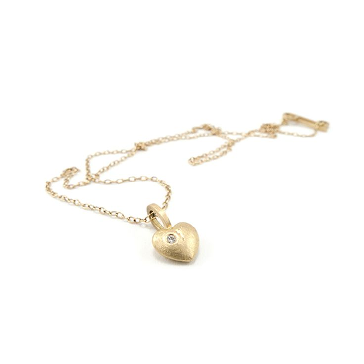 Gold heart with brillant. Karina Bach-Lauritsen