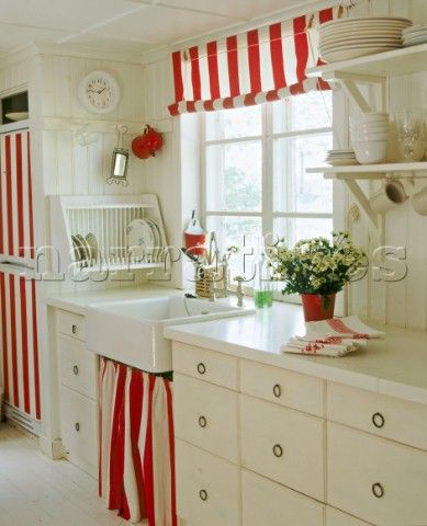 A Country Kitchen In Neutral Colours Belfast Sink Painted Units Red And White Striped Blind