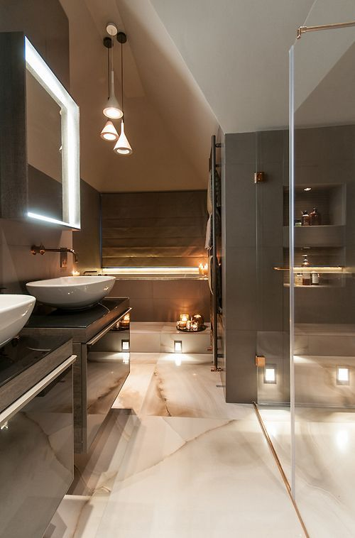 love the way this led tape and plinth lighting highlight alcoves in this bathroom scene