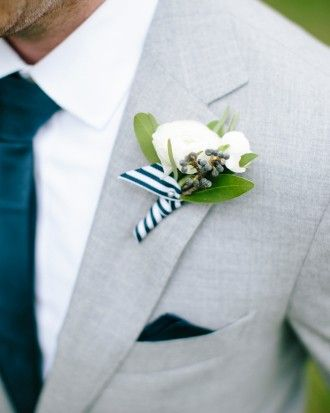 Kristen and Jonathan | Martha Stewart Weddings - White ranunculus, olive leaves, and tiny blue berries found growing on the island were wrapped with blue-and-white striped ribbon for the boutonnieres.