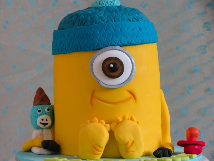 Minion Baby Shower Cake with baby feet and a beanie