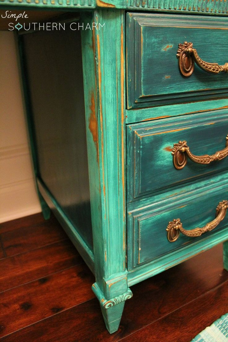 I rescued this gorgeous desk from a grungy old garage having already had my plan of attack in minds. I love blues and greens in particular, teal and turquoise. After seeing how the drawer pulls cleaned up, I knew my color combo was going to be perfect! You can't tell from this photo, but they …
