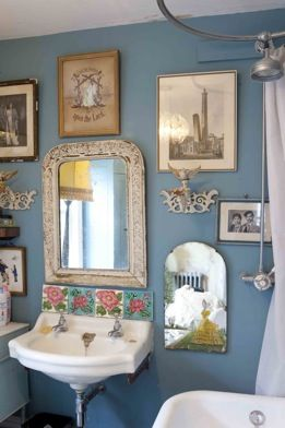 Nostalgic collection really pops on this delightful blue wall. I really love arranging pictures in a collage style.