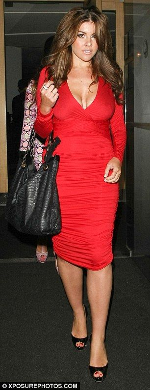 Scarlet woman: Featuring a daring plunging neckline and a flattering midi hem, the 30-year-old reality star's stunning scarlet dress ensured...
