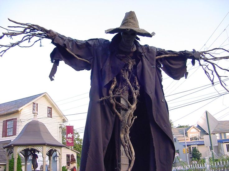 Pumpkinrot.com has some of the most amazing scarecrows.  I love this one's simplicity yet creepiness.