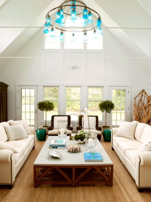 vaulted ceiling, oversize coffee table, topiary, driftwood object...perfection