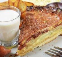 Recette - Quiche au lard fumé, oignons et fromage - Notée 4.9/5 par les internautes