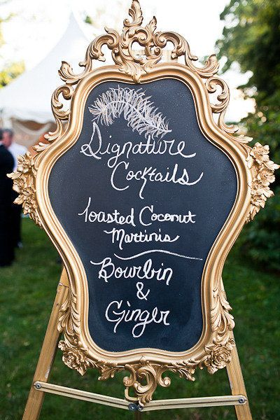 A chalkboard sign made glamorous with an ornate gold frame. | Photography: Rebecca Arthurs Photography,Floral + Custom Design: Perfect Surro...