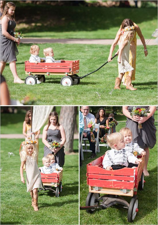 ring bearers in a red wooden wagon #weddingchicks http://www.weddingchicks.com/2013/12/18/colorado-wedding/