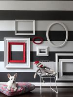 What a Great Idea!  Came across this in a magazine...Just have to say Wow, that's impact!  Grab your old frames and empty them, scrape them and paint them and STYLE THEM!  Think I'll try a nautical look.