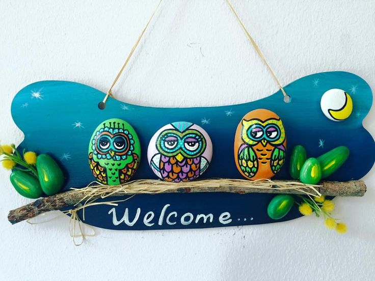 Welcome sign with painted rocks of cute owls.