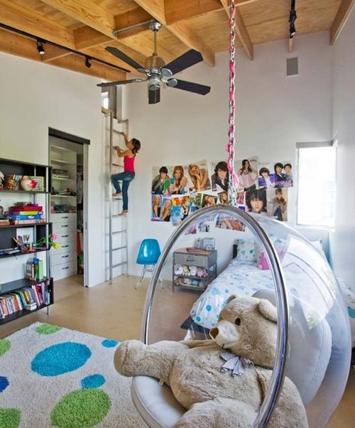 Fun kid room with ladder to hideaway and bubble swing.