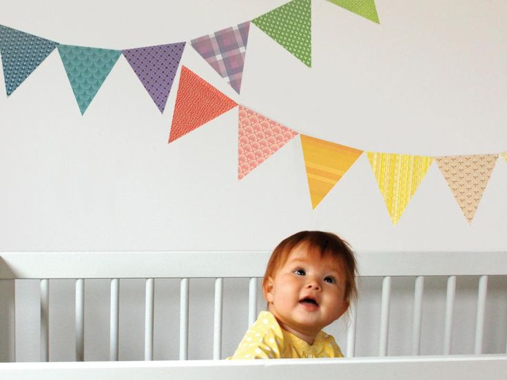 What better way to announce a new baby than some bunting? Most decals are vinyl, but these pennants are actually made of adhesive fabric that you can reuse. Because the banner is rip- and wrinkle-resistant, you can easily move it from over a crib to decorate for a child's birthday party. Photo courtesy of Petit Collage