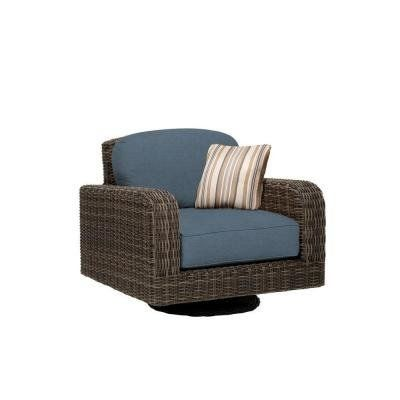 Northshore Patio Lounge Chair in Denim with Bazaar Throw Pillow -- CUSTOM. Fully assembled. Industry leading heavy gauge aluminum frame. Fully hand-woven frame and seat. 100% exclusive Sunbrella acrylic fabric. High quality outdoor cushion fill for lasting comfort and durability.