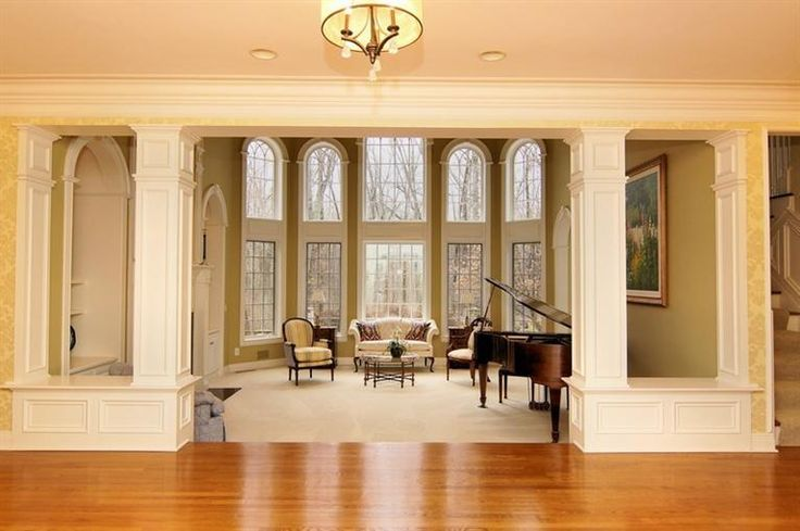 9155 Whisperinghill Dr Indian Hill, OH 45242 Wall-to-ceiling windows – a grand living room