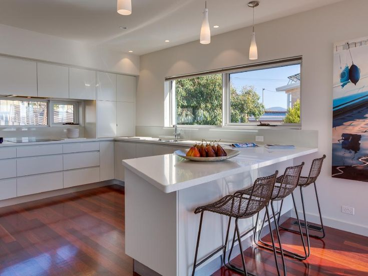 Luxurious modern living is exemplified through the beautiful open plan kitchen with glossy Jarrah floorboards. Read the full story here: http://www.theaustralian.com.au/news/properties-of-the-weekend/image-gallery/f72ae658ab953e3600db9eee4a8b6f6a