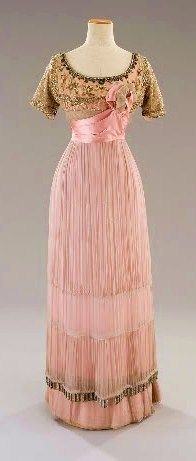 Pink Edwardian dress. Love the unconventional use of pink and gold, and the contrast of tiny pleats and beading.