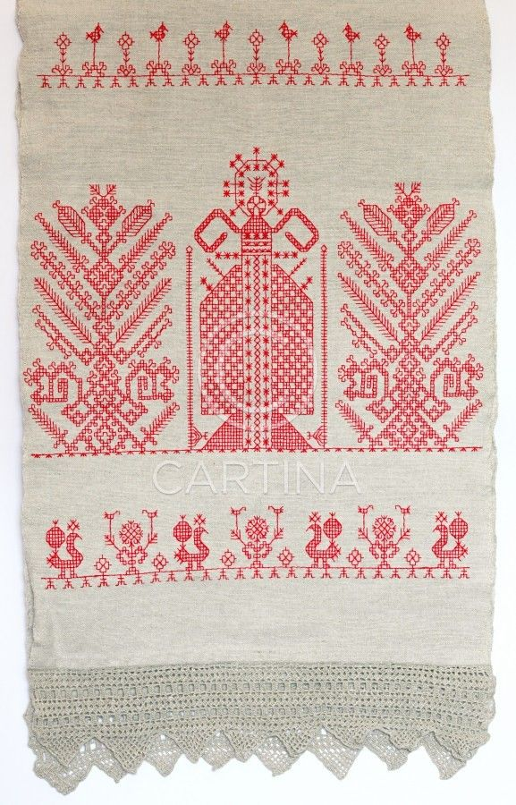 """An old traditional embroidery """"käspaikka"""" with vivid red thread."""