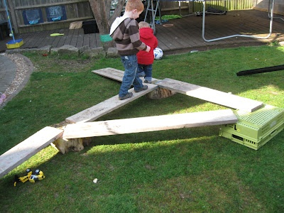 Risk taking with under two's...make shift balance beams.