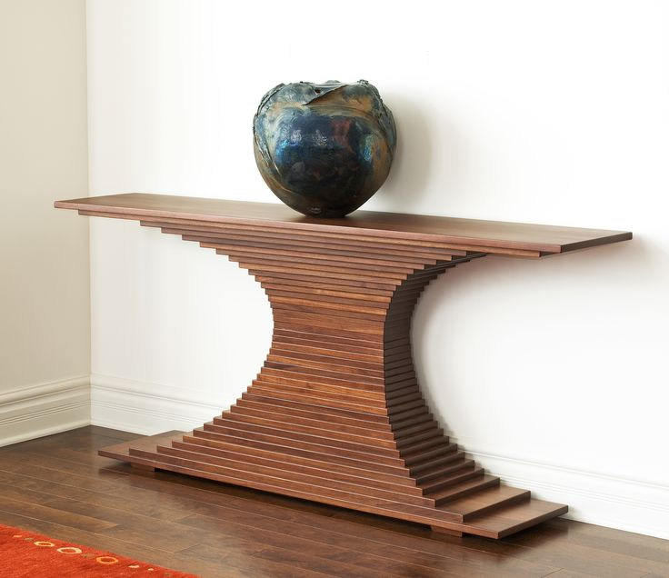 An exquisite balance of form and texture for a modern interior -- Inspired by a client's suggestion, our craftsmen, Ron & Steve, created this custom sculptural console. Our craftsmen's experienced skill and eye were essential to making a piece structurally sound and beautiful for years to come. http://www.sawbridge.com/