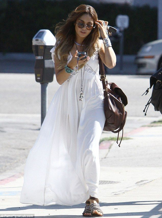 Boho beauty: Vanessa Hudgens looked positively angelic as she stepped out in an ethereal flowing white maxi dress on Sunday afternoon