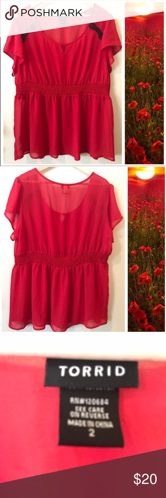 """Just In 🌹Torrid Red Empire Baby doll Top 🌹 Preloved in great conditions, Torrid sheer red top with flutter cap sleeves, peek hole in the neckline & Black Lace On shoulders. Elastic around waist. 🌹Approx Length it's 28"""" & 22""""Bust Laying Flat. It's size 2 on Torrid, means it's 18/20.  Super cute and sexy top. 🌹 torrid Tops Blouses"""