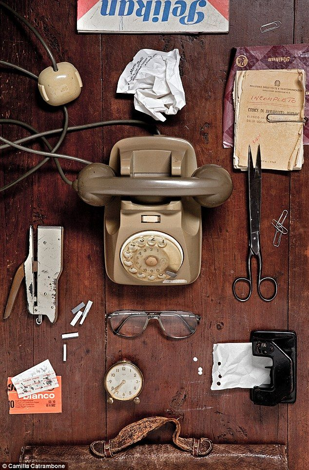 Grandpa Mario: Catrambone reveals an old telephone, eyeglasses, cigarette papers, a stapler, and more to represent her memory of this particular family member