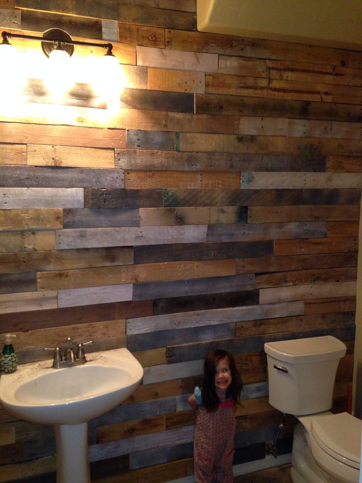 Pallet wood slats accent wall in our bathroom I did. And ...
