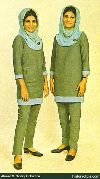 1966-1975  (Ahmad Saeed Siddiqi Collection)  PIA Air Hostesses Sitara Butt (left) and Tahira Mali modelling for the uniform designed by French fashion designer Pierre Cardin