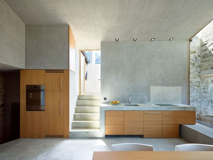 Despite the name, delicate lines of glass and plaster run through the Scaiano Stone House.  In the small Swiss village of Scaiano, near the Italian border, a former brandy distillery sits amidst a cluster of old homes, a hamlet so old that you can't drive your car down the narrow streets and...
