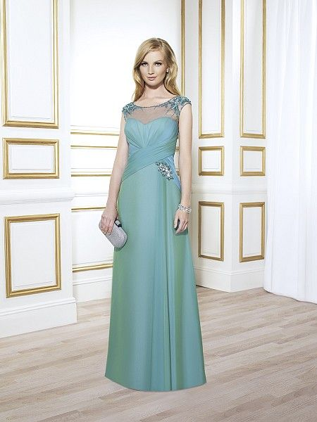 Val Stefani Style MB7402 A trumpet style gown with beaded cap sleeves and a boat neckline. The inverted basque waist is embellished with a beaded motif that leads into two-toned chiffon fabric.