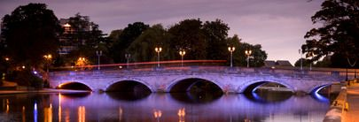 View from the Embankment by the River Ouse looking towards the bridge and Bedford at twilight in Bedfordshire., Bedford, Bedfordshire, England