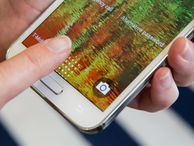 Samsung reportedly to unveil two versions of Galaxy S6 One model would be designed with metal, while the other would feature a curved edge like that of the Galaxy Note Edge, a report says.