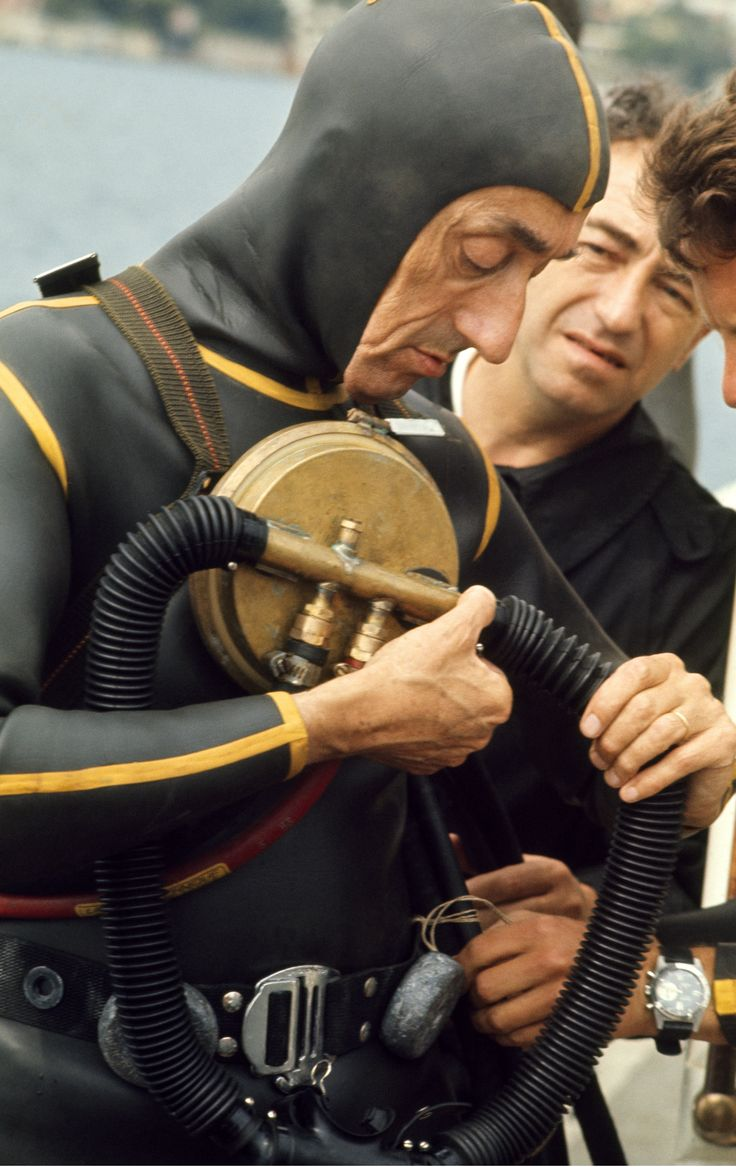 Marine explorer Jacques Cousteau tests his breathing apparatus before a dive off…  http://divingtales.com
