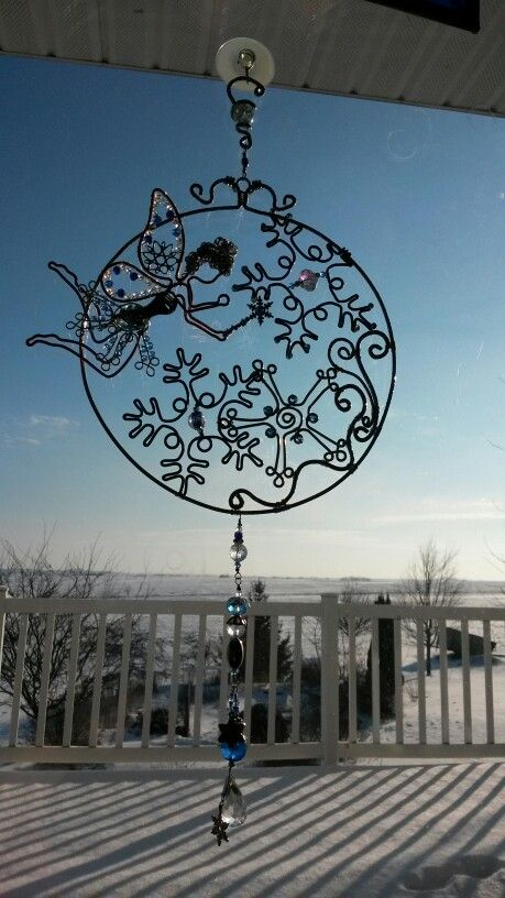 Frozen snowflake fairy sun catcher with hammered aluminum wire, beaded wire wrapped.