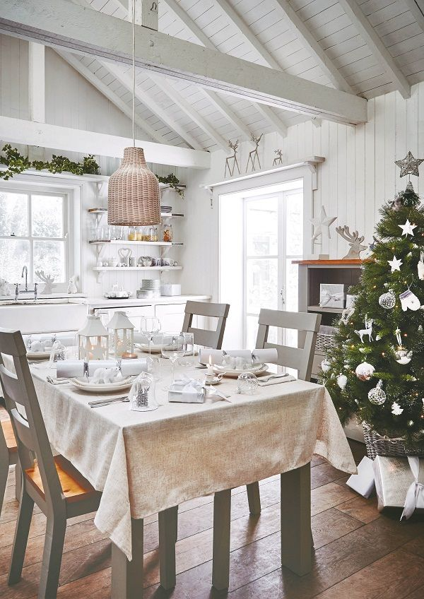 Take inspiration from Scandinavia with their grey painted wooden furniture and their offerings of stags heads, reindeer's and even polar bears to create a Nordic forest scheme. Plain white linen, white lanterns and silver stars continue the theme of a snowy landscape