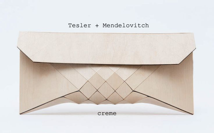 """These architectural look, artisanal """"wood skin"""" purses are constructed from 100% wood, 100% hide. While the geometric surface design provides necessary flexibility, the wood texture is soft to the touch, at once both delicate and wear resilient. Timeless yet innovative, these clutches will never go out of style."""