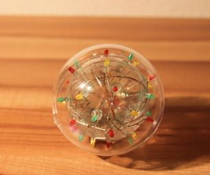 Flashing LED ball with saline water