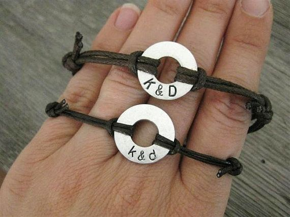 His and Hers matching stamped bracelets. Cheaper way: Get two washers, a sharpie, and some string and use the tutorial in the DIY Arts & Crafts board.