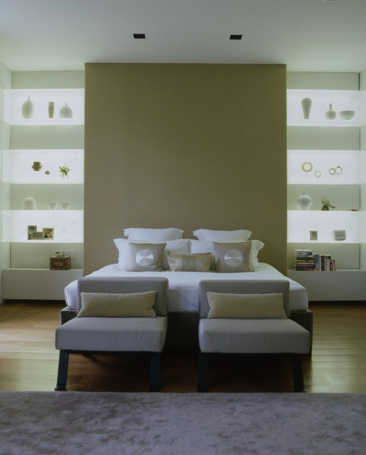 Great idea to backlight the shelving in the alcove as low level bedroom lighting.  Avoiding bedside table lamps.