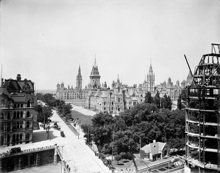 Unusual photo of downtown Ottawa taken from the top of the lost Corrie Block circa 1910-11, as construction continued on the Chateau Laurier (right). On the left you can see the Old Post Office, with its basement terrace down to the Rideau Canal. In the background is the original Centre Block. As for the driving ... it seems everyone is still in horse and carriage!...