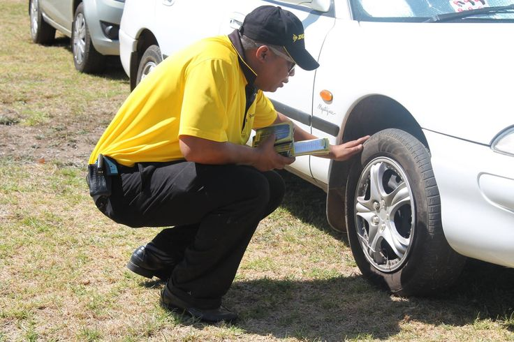 The Dunlop Technical Team inspecting tyres #KeepingYouSafe