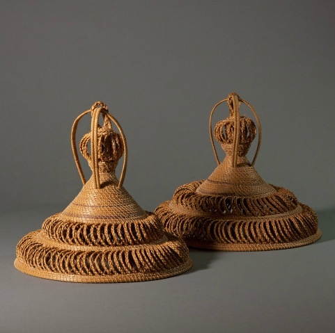 Africa | Sotho Hats - Lesotho These intricately woven and decorative hats are from the Basotho, or 'people of Lesotho,' a country within South Africa. Made from straw, they are topped with a complicated knot. It is said that the number of handles on a conical hat indicate a man's status. The shape of the hat is believed to be from a cone-shaped mountain located in the Lesotho region.
